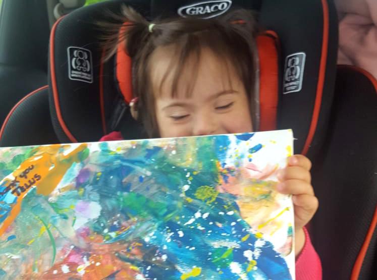 Amelie Pelen paints a special thank you for TELUS tablet donation